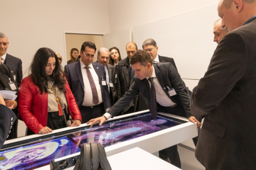 Prof. Dr. Mircea Muresan presenting UMCH's 3D anatomy and dissection table after the opening ceremony
