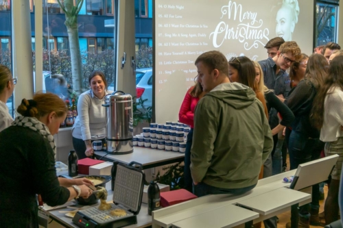 Students waiting for fresh waffles at UMCH Christmas party