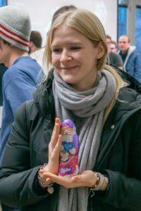 UMCH student holding a chocolate Santa